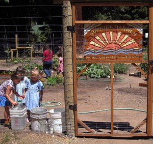 Photo of kids and adults enjoy bruno farnocchia community garden guerneville ca