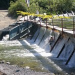 teenagers cooling off vacation beach dam spillway guerneville california
