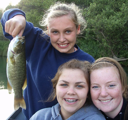 Happy Girls with Small Mouth Bass Fishing Catch