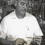 Historic Gallery Archive: Grant King of King's News and Tackle tying fishing lures (c.1950s)