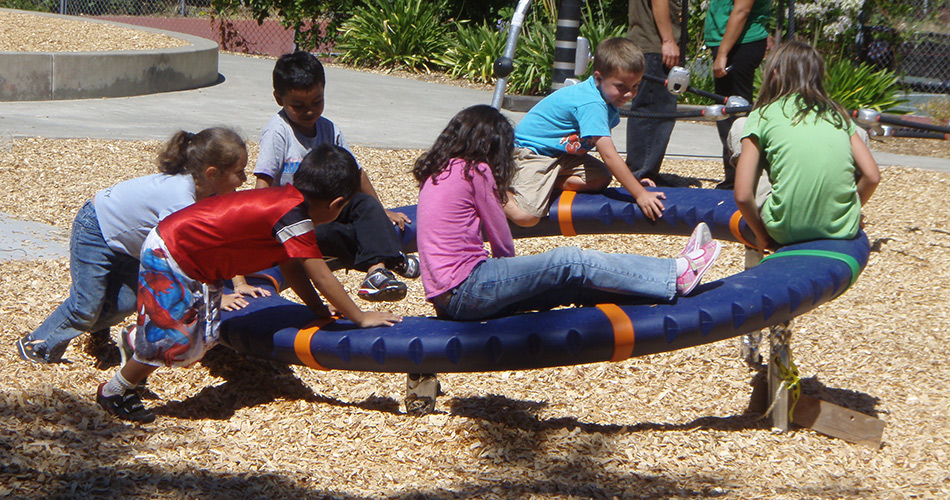 Kids on spinning wheel ~ J K Wright Playground, Guerneville California